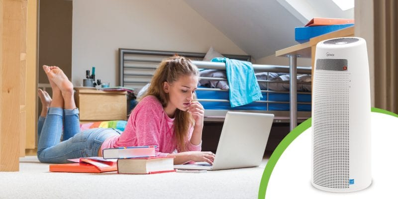 Girl in dorm on computer listening to QS Air Purifier play music